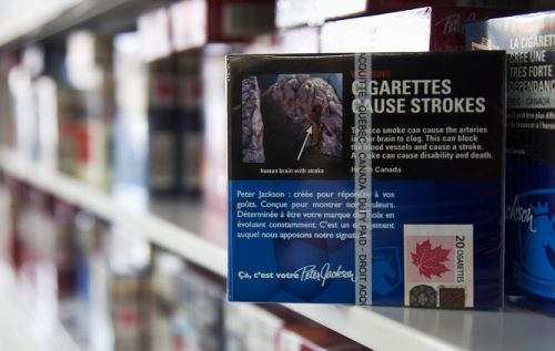 Cigarettes sit on a shelf in this picture illustration taken in Montreal