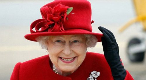 Britain's Queen Elizabeth II holds on to her hat in high winds as she arrives for a visit to RAF Valley in Anglesey, Wales on April 1, 2011. Britain's Queen Elizabeth II and Prince Philip, The Duke of Edinburgh today visited RAF Valley in Anglesey in high and were given a personal tour of an RAF search and rescue helicopter by Prince William. AFP PHOTO / Christopher Furlong /WPA POOL