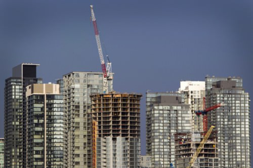 A series of condominium construction projects stand in Toronto, Ontario, Canada, on Tuesday, July 19, 2011. Canadian housing starts rose faster than forecast to an 11-month high in June, according to a federal government agency. Multiple-unit urban projects such as condominiums fell 3.1 percent to 103,700 units. Photographer: Brent Lewin/Bloomberg