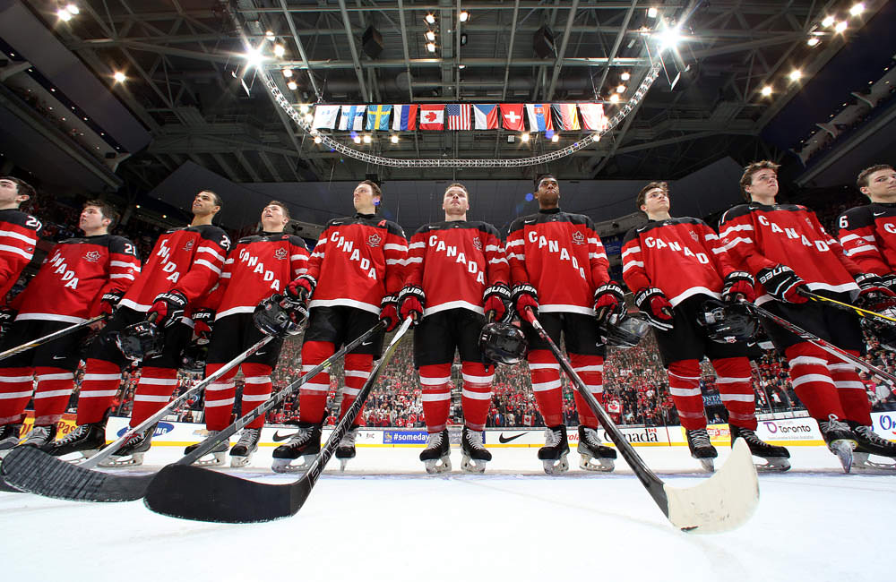 TORONTO, CANADA - JANUARY 2: Canadian players look on during the national anthem after a quarterfinal round win over Denmark at the 2015 IIHF World Junior Championship. (Photo by Andre Ringuette/HHOF-IIHF Images)